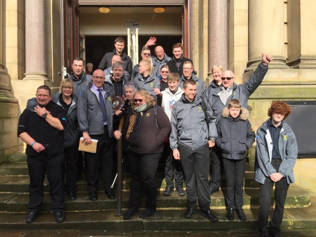 Lofthouse Brass Band celebrate on Huddersfield Town Hall steps